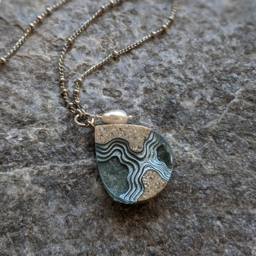 Tombolo necklace resin and beach sand at the gallery and gift shop